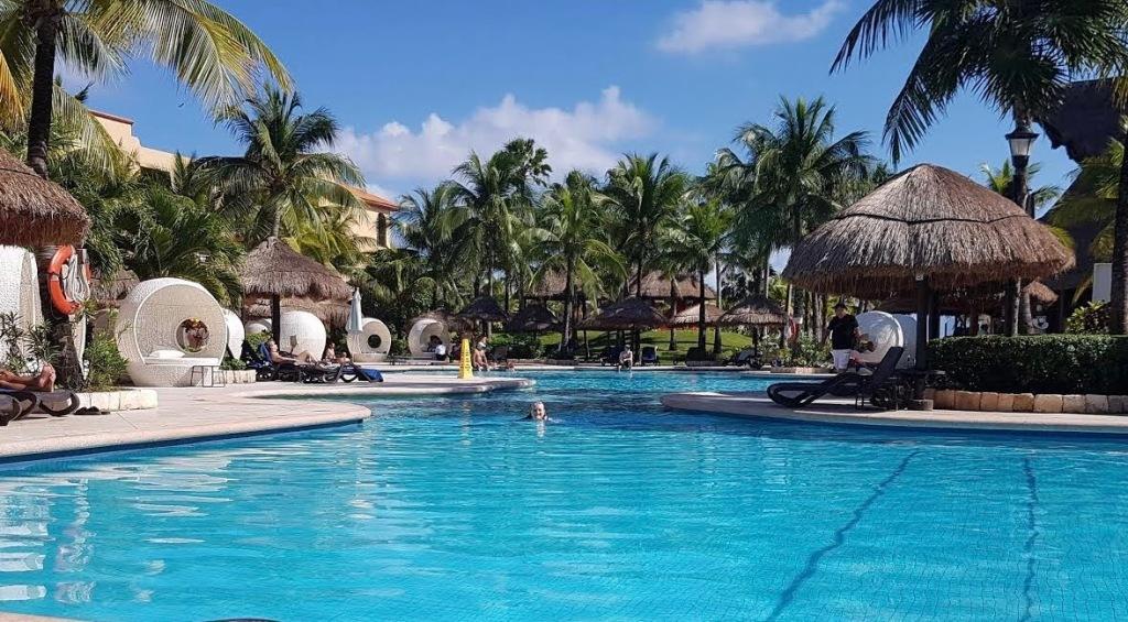 Swimming in one of the pools at Sandos Playacar Beach Resort